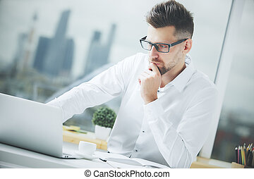 Attractive man working on project