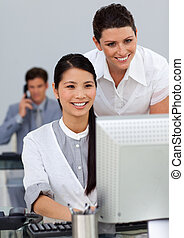 Attractive manager checking her employee\'s work