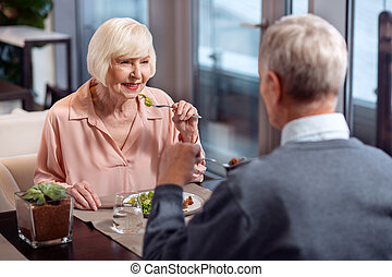 Attractive mature couple communicating during dinner