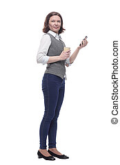 attractive mature woman with smartphone and coffee to take away.
