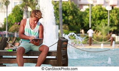 attractive men using digital tablet