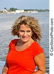 Attractive Middle Age Woman Wearing a Red Top