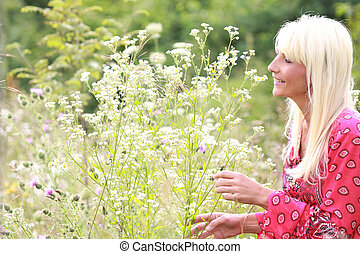 attractive middle age woman with natural flowers