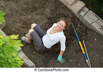 Attractive middle-aged female gardener