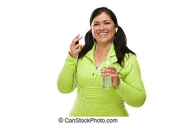 Attractive Middle Aged Hispanic Woman In Workout Clothes with Music Player, Headphones and Water Against a White Background.
