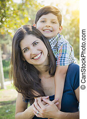 Attractive Mixed Race Mother and Son Hug in Park