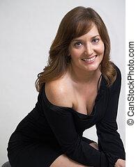 attractive model wearing a black dress