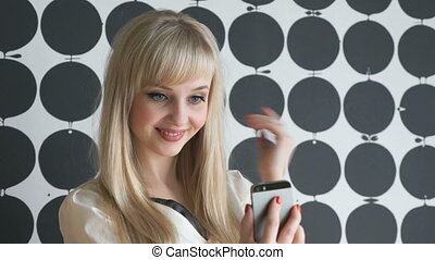 Attractive model girl making selfies at the cafe