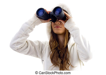 attractive model watching through binocular on an isolated ...