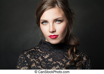Attractive model woman on black background