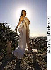 Attractive model wrapped in a sheet