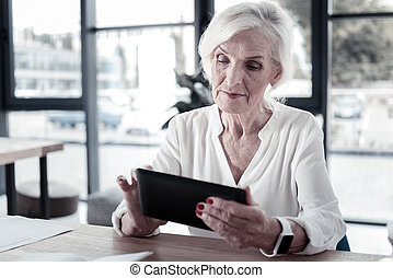 Attractive modern businesswoman leaning arms on the table