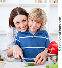 Attractive mother and her son cooking