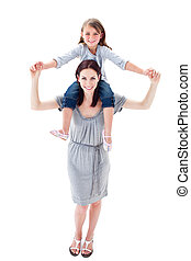 Attractive mother giving her daughter piggyback ride