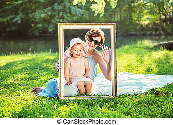 Attractive mother posing with her cute daughter