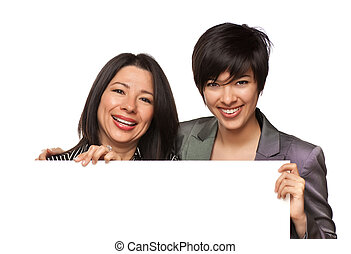 Attractive Multiethnic Mother and Daughter Holding Blank White Sign Isolated on a White Background.