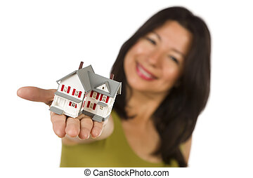 Attractive Multiethnic Woman Holding Small House