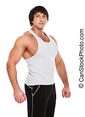 Attractive muscular guy in fitness wear
