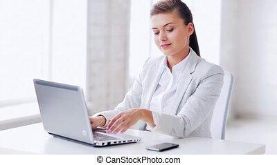 attractive office worker taking phone call
