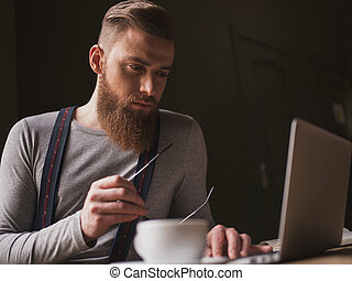Attractive old-fashioned guy with modern technology