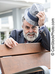 Attractive old man with beard and hat