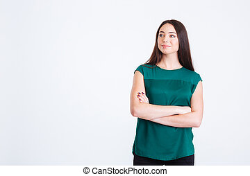 Attractive pensive young woman standing with hands folded