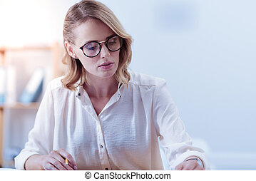 Attractive pleasant woman being involved in work