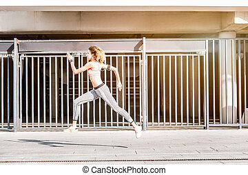 Attractive pleasant young woman running very fast