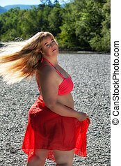 Attractive plus size woman in colorful red