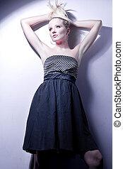 Attractive posing blonde in a pretty dress.