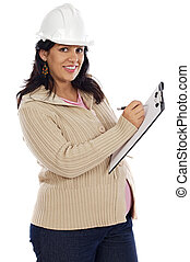 Attractive pregnant engineer on a over white background