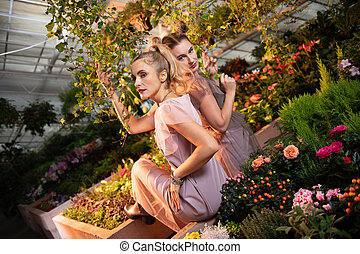 Attractive pretty women visiting a botanical garden