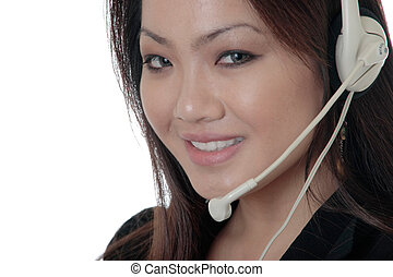 Attractive receptionist wearing headset up close on white...