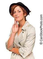 Attractive Red Haired Girl Wearing a Trenchcoat and Hat