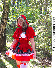 attractive Red Riding Hood in the forest