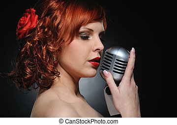 Attractive redhead woman with retro microphone