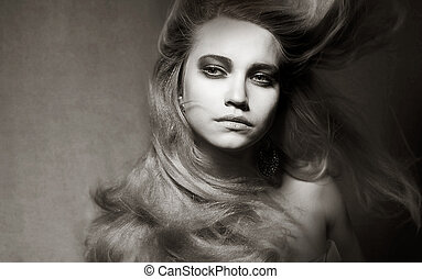 Attractive Romantic Girl with Windy Hair in Shadows