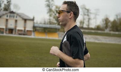 Attractive Runner in Yellow Sunglasses