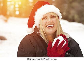 Attractive Santa Hat Wearing Blond Woman Having Fun in Snow