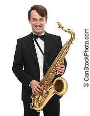 Attractive saxophonist with a saxophone in a suit. -...