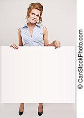 Attractive secretary over white empty board, lots of copyspace