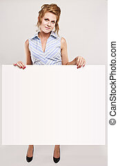 Attractive secretary over white empty board, lots of copyspace