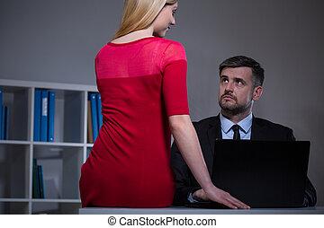 Attractive secretary seducing boss