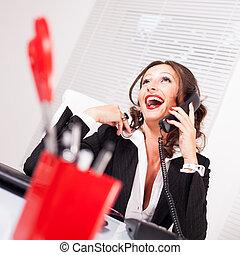 Attractive secretary talking on the phone