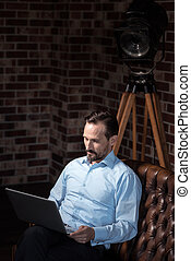 Attractive self employed man concentrating on his work