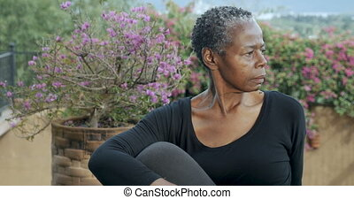 Attractive senior African American woman holding sitting...