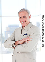Attractive senior businessman with folded arms