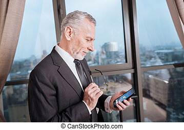 Attractive senior man checking his messages