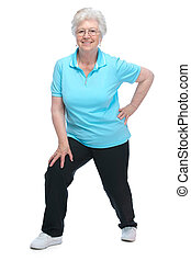 Attractive senior woman at health club, doing stretching ...
