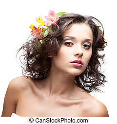 attractive sensual brunette woman with flower in hair